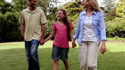 stock-footage-young-family-taking-a-walk-in-a-park