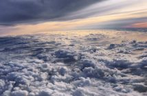nature___clouds_flying_above_the_clouds_at_sunset_094823_